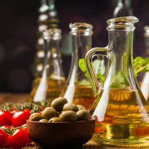 Composition of olive oils in bottles with ingriedients